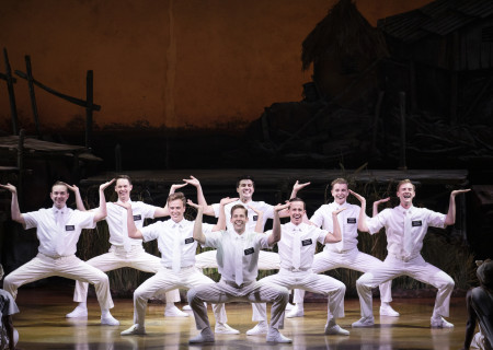 """The company of """"The Book of Mormon."""" With book, music and lyrics by Trey Parker, Robert Lopez and Matt Stone, choreographed by Casey Nicholaw, and direction by Nicholaw and Parker, """"The Book of Mormon"""" will be presented by Center Theatre Group at the Ahmanson Theatre February 18 through March 29, 2020. For more information, please visit CenterTheatreGroup.org. Press Contact: CTGMedia@CTGLA.org / (213) 972-7376. Photo by Julieta Cervantes."""