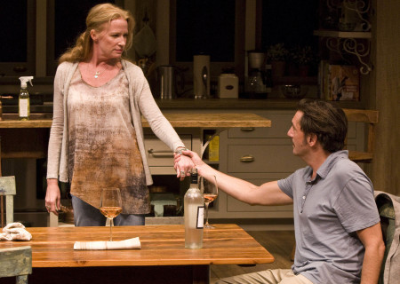 "(L–R) Johanna Day and Reg Rogers in the world premiere of Theresa Rebeck's ""Poor Behavior"" at the Mark Taper Forum. ""Poor Behavior,"" directed by Doug Hughes, opens September 18 and continues through October 16, 2011."