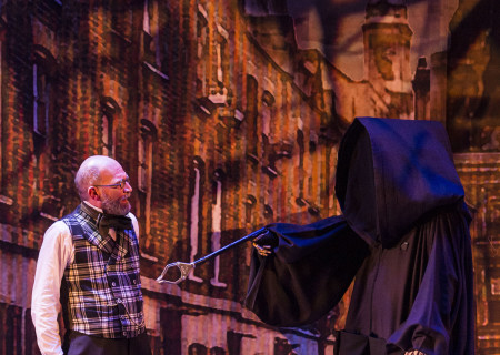 "(L–R) Ron West and Brian Stepanek (as the Ghost of Christmas Future) in The Second City's ""A Christmas Carol: Twist Your Dickens!"" at the Douglas."