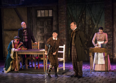 "(L–R) Larry Joe Campbell, Ron West, Jean Villepique, Brian Stepanek, and Amanda Blake Davis in The Second City's ""A Christmas Carol: Twist Your Dickens!"" at the Douglas."