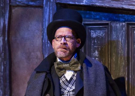 """Ron West in The Second City's """"A Christmas Carol: Twist Your Dickens!"""" at the Kirk Douglas Theatre."""