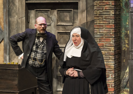 """Ron West and Jaime Moyer in The Second City's """"A Christmas Carol: Twist Your Dickens!"""" at the Kirk Douglas Theatre."""