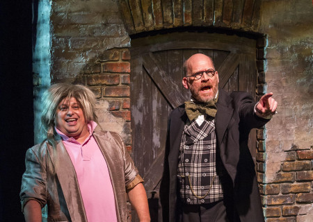 """(L–R) Frank Caeti and Ron West in The Second City's """"A Christmas Carol: Twist Your Dickens!"""" at the Kirk Douglas Theatre."""