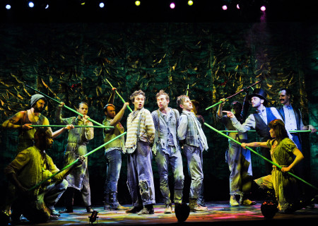 """(Center, L–R)  Edward Tournier, Joey deBettencourt, and Carl Howell with the company of  """"Peter and the Starcatcher."""""""