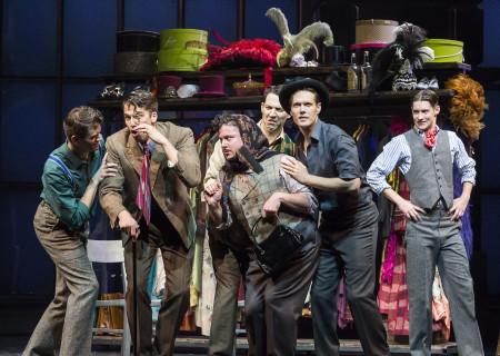 "(L–R) Shayne Kennon, Douglas Williams, Will Blum (scarf), Matt Bailey, Will Taylor, and Chris Dwan in ""Harmony"" at the Ahmanson Theatre."