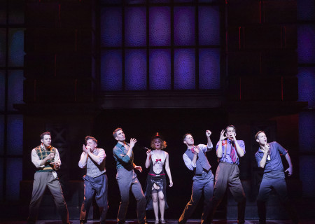"(L–R) Matt Bailey, Will Blum, Shayne Kennon, Lauren Elaine Taylor, Chris Dwan, Douglas Williams, and Will Taylor in ""Harmony"" at the Ahmanson Theatre."