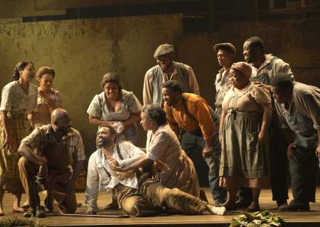 """Nathaniel Stampley (seated center) and the cast of """"The Gershwins' Porgy and Bess."""""""