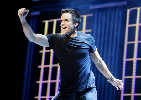 """Brian Justin Crum in the national tour of Queen and Ben Elton's """"We Will Rock You."""""""