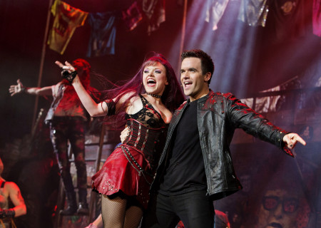 """Ruby Lewis and Brian Justin Crum in the national tour of Queen and Ben Elton's """"We Will Rock You."""""""