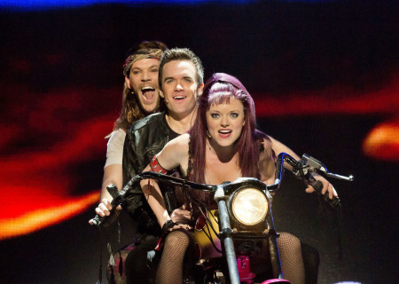 """(L–R) Ryan Knowles, Brian Justin Crum and Ruby Lewis in the national tour of Queen and Ben Elton's """"We Will Rock You."""""""