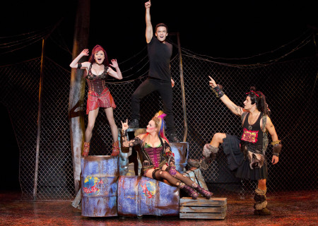"""(L–R) Ruby Lewis, Brian Justin Crum, Erica Peck, and Jared Zirilli in the national tour of Queen and Ben Elton's """"We Will Rock You."""""""