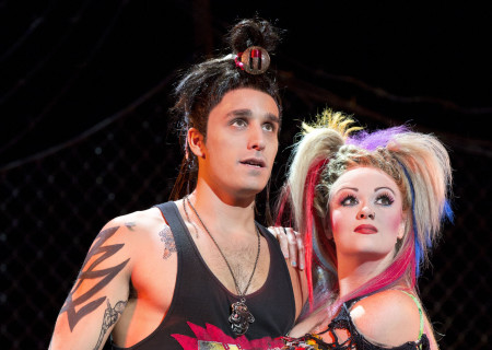 """Jared Zirilli and Erica Peck in the national tour of Queen and Ben Elton's """"We Will Rock You."""""""