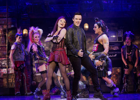 """The cast of the national tour of Queen and Ben Elton's """"We Will Rock You."""""""