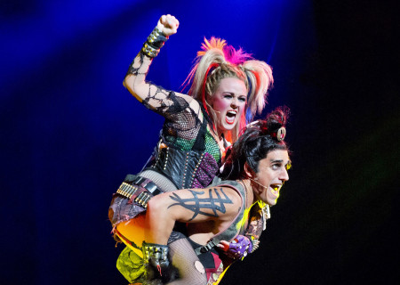 """Erica Peck and Jared Zirilli in the national tour of Queen and Ben Elton's """"We Will Rock You."""""""