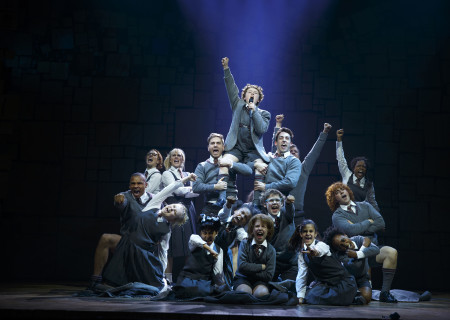 Evan Gray (top center) and the company of 'Matilda The Musical' in the National Tour at Ahmanson Theatre. <br />