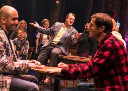"L-R: Nick Duckart, Kevin Carolan and Andrew Samonsky surrounded by the company of the First North American Tour of ""Come From Away."" With a book, music and lyrics by Tony and Grammy Award nominees Irene Sankoff and David Hein and direction by Christopher Ashley, ""Come From Away runs November 28, 2018 through January 6, 2019 at Center Theatre Group/Ahmanson Theatre in Los Angeles, CA. For tickets and information, please visit CenterTheatreGroup.org or call (213) 972-4400. Media Contact: CTGMedia@CTGLA.org / (213) 972-7376. Photo by Matthew Murphy."