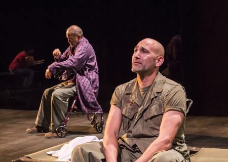 "L-R: Rubén Garfias (background) and Jason Manuel Olazábal in ""Elliot, A Soldier's Fugue"" at Center Theatre Group's Kirk Douglas Theatre. Directed by Shishir Kurup and written by Quiara Alegría Hudes, ""Elliot, A Soldier's Fugue"" will play through February 25, 2018. For tickets and information, please visit CenterTheatreGroup.org or call (213) 628-2772. Media Contact: CTGMedia@CTGLA.org / (213) 972-7376. Photo by Craig Schwartz."