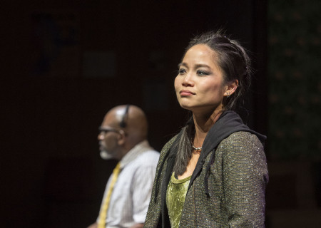 "Sylvia Kwan (foreground) and Bernard K. Addison (background) in the Center Theatre Group production of ""Water by the Spoonful"" at the Mark Taper Forum. Directed by Lileana Blain-Cruz and written by Quiara Alegría Hudes, ""Water by the Spoonful"" will play through March 11, 2018. For tickets and information, please visit CenterTheatreGroup.org or call (213) 628-2772. Media Contact: CTGMedia@CTGLA.org / (213) 972-7376. Photo by Craig Schwartz."