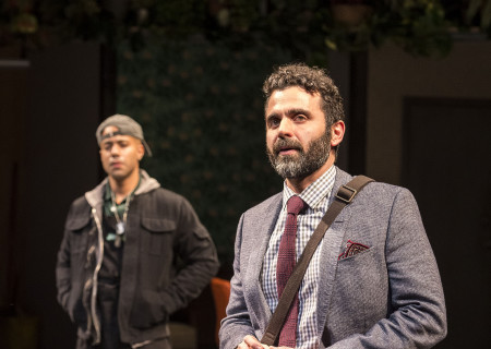 "L-R: Sean Carvajal (background) and Nick Massouh (foreground) in the Center Theatre Group production of ""Water by the Spoonful"" at the Mark Taper Forum. Directed by Lileana Blain-Cruz and written by Quiara Alegría Hudes, ""Water by the Spoonful"" will play through March 11, 2018. For tickets and information, please visit CenterTheatreGroup.org or call (213) 628-2772. Media Contact: CTGMedia@CTGLA.org / (213) 972-7376. Photo by Craig Schwartz."