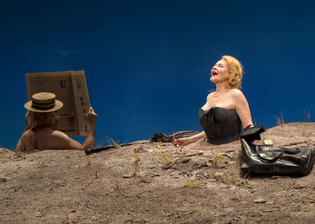 "L-R: Michael Rudko (obscured) and Dianne Wiest in the Yale Repertory Theatre production of Samuel Beckett's ""Happy Days"" at the Mark Taper Forum. Directed by James Bundy, ""Happy Days"" will play at the Taper through June 30, 2019. For tickets and information, please visit CenterTheatreGroup.org or call (213) 628-2772. Media Contact: CTGMedia@CTGLA.org / (213) 972-7376. Photo by Craig Schwartz."