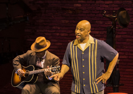 "L-R: Chris Thomas King (background) and Ruben Santiago-Hudson in the Center Theatre Group production of ""Lackawanna Blues."" Written and directed by Santiago-Hudson, ""Lackawanna Blues"" will play at the Mark Taper Forum through April 21, 2019. For tickets and information, please visit CenterTheatreGroup.org or call (213) 628-2772. Press Contact: CTGMedia@CTGLA.org / (213) 972-7376. Photo by Craig Schwartz."
