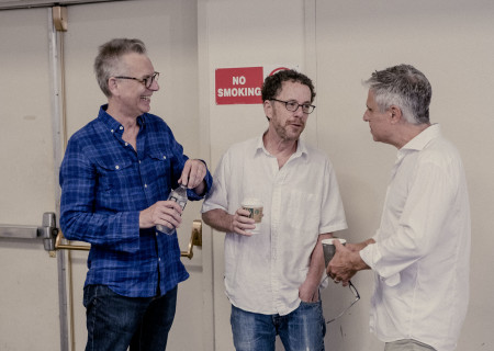 "L-R: Center Theatre Group Artistic Director Michael Ritchie, Ethan Coen and Neil Pepe at the first rehearsal for the world premiere of ""A Play Is a Poem."" Written by Coen and directed by Pepe, ""A Play Is a Poem"" runs September 11 through October 13, 2019, at Center Theatre Group/Mark Taper Forum. For tickets and information, please visit CenterTheatreGroup.org or call (213) 628-2772. Media Contact: CTGMedia@CTGLA.org / (213) 972-7376. Photo by Benedict Evans."