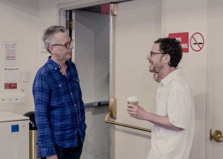 "L-R: Center Theatre Group Artistic Director Michael Ritchie and Ethan Coen at the first rehearsal for the world premiere of ""A Play Is a Poem."" Written by Coen and directed by Neil Pepe, ""A Play Is a Poem"" runs September 11 through October 13, 2019, at Center Theatre Group/Mark Taper Forum. For tickets and information, please visit CenterTheatreGroup.org or call (213) 628-2772. Media Contact: CTGMedia@CTGLA.org / (213) 972-7376. Photo by Benedict Evans."