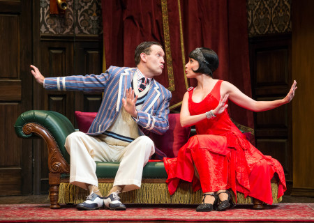 "L-R: Ned Noyes and Jamie Ann Romero in the national tour of ""The Play That Goes Wrong."" Written by Henry Lewis, Jonathan Sayer and Henry Shields and directed by Mark Bell, ""The Play That Goes Wrong"" will be presented by Center Theatre Group at the Ahmanson Theatre July 9 through August 11, 2019. For more information, please visit CenterTheatreGroup.org. Press Contact: CTGMedia@CTGLA.org / (213) 972-7376. Photo by Jeremy Daniel."