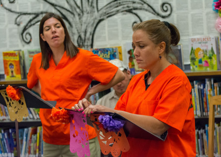 L-R: Fernanda Shakti Kelly and Jessica Pacheco perform in a library play reading presented by Center Theatre Group. The 2019 library play readings will be presented on various dates from July to December at Benjamin Franklin Library, Malabar Library and Robert Louis Stevenson Library. Photo by Hal Banfield.