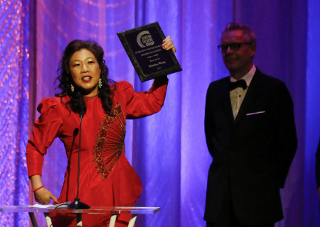 L-R: The 2019 Dorothy and Richard E. Sherwood Award Recipient Kristina Wong and (background) Center Theatre Group Artistic Director Michael Ritchie during the 29th Annual LA Stage Alliance Ovation Awards held at The Theatre at Ace Hotel on January 28, 2019 in Los Angeles, California. Media Contact: CTGMedia@CTGLA.org / (213) 972-7376. Photo by Ryan Miller/Capture Imaging.