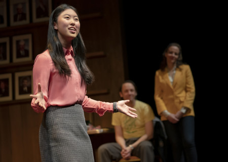 "L-R: Jocelyn Shek, (background) Mike Iveson and Maria Dizzia in the national tour of ""What the Constitution Means to Me."" Written by Heidi Schreck and directed by Oliver Butler, ""What the Constitution Means to Me�� is presented by Center Theatre Group at the Mark Taper Forum through February 28, 2020. For more information, please visit CenterTheatreGroup.org. Press Contact: CTGMedia@CTGLA.org / (213) 972-7376. Photo by Joan Marcus."