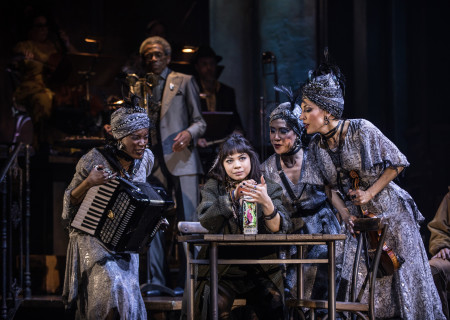 "L-R: Jewelle Blackman, André De Shields (background), Eva Noblezada, Kay Trinidad and Yvette Gonzalez-Nacer in the Original Broadway Cast of ""Hadestown."" The national tour of ""Hadestown"" will be part of Center Theatre Group's 2020-2021 season at the Ahmanson Theatre. For more information, please visit CenterTheatreGroup.org. Press Contact: CTGMedia@CTGLA.org / (213) 972-7376. Photo by Matthew Murphy."