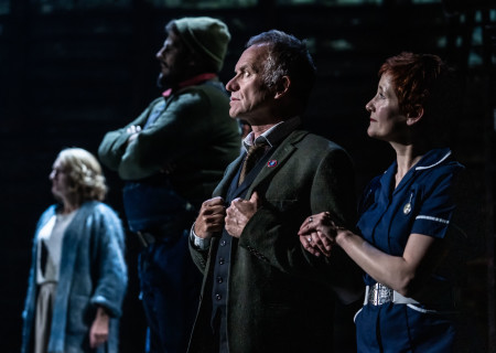 "L-R (foreground): Sting and Jackie Morrison in ""The Last Ship."" With a new book and direction by Lorne Campbell (original book by John Logan and Brian Yorkey) and music and lyrics by Sting, ""The Last Ship"" is presented by Center Theatre Group at the Ahmanson Theatre through February 16, 2020. For more information, please visit CenterTheatreGroup.org. Press Contact: CTGMedia@CTGLA.org / (213) 972-7376. Photo by Matthew Murphy."