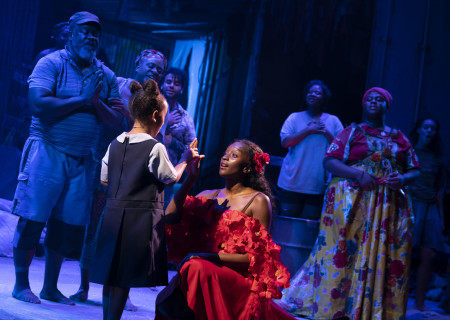 """MiMi Crossland (center left) and Courtnee Carter (center right) with the company of """"Once on This Island."""" With book and lyrics by Lynn Ahrens, music by Stephen Flaherty, choreography by Camille A. Brown and directed by Michael Arden, """"Once on This Island"""" is presented by Center Theatre Group at the Ahmanson Theatre April 7 through May 10, 2020. For more information, please visit CenterTheatreGroup.org. Press Contact: CTGMedia@CTGLA.org / (213) 972-7376. Photo by Joan Marcus."""