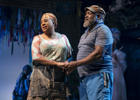 """L-R: Danielle Lee Greaves and Phillip Boykin in """"Once on This Island."""" With book and lyrics by Lynn Ahrens, music by Stephen Flaherty, choreography by Camille A. Brown and directed by Michael Arden, """"Once on This Island"""" is presented by Center Theatre Group at the Ahmanson Theatre April 7 through May 10, 2020. For more information, please visit CenterTheatreGroup.org. Press Contact: CTGMedia@CTGLA.org / (213) 972-7376. Photo by Joan Marcus."""