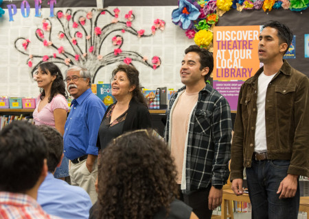 """L-R: Gaby Mayorga, Alberto Isaac, VIVIS, Moises Castro and Israel Reyes-Lopez perform in a library play reading of Luis Alfaro's """"Mama of the Row"""" directed by Nancy Keystone. Center Theatre Group will present the 2020 library play readings on various dates from January to June at Benjamin Franklin Library, Malabar Library and Robert Louis Stevenson Library. Photo by Cristi Burgos."""