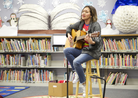 """Cheryl Umaña-Bonilla performs in a library play reading of Diana Burbano's """"Linda"""" directed by Alejandra Cisneros. Center Theatre Group will present the 2020 library play readings on various dates from January to June at Benjamin Franklin Library, Malabar Library and Robert Louis Stevenson Library. Photo by Cristi Burgos."""