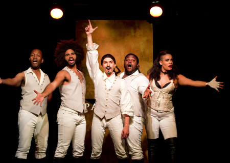 "L-R: Chris Anthony Giles, Nicholas Edwards, Dan Rosales, Juwan Crawley and Nora Schell in the Off-Broadway production of ""Spamilton"" at the Triad. ""Spamilton"" will play the 2017-2018 season at Center Theatre Group's Kirk Douglas Theatre November 5 through December 31, 2017. For season tickets and information, please call (213) 972-4444, visit www.CenterTheatreGroup.org or www.Spamilton.com. Media Contact: CTGMedia@CTGLA.org / (213) 972-7376. Photo by Carol Rosegg."