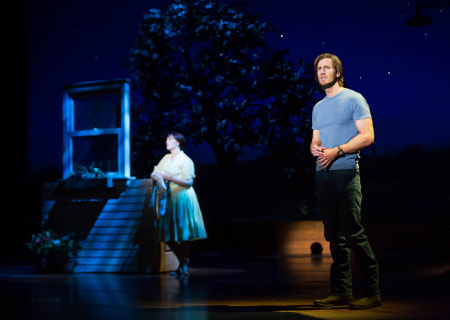 "Elizabeth Stanley (background) and Andrew Samonsky in the Tony Award-winning ""The Bridges of Madison County"" The Broadway Musical at the Center Theatre Group/Ahmanson Theatre, December 8, 2015, through January 17, 2016. ""Bridges"" has a book by Marsha Norman, music and lyrics by Jason Robert Brown and is based on the novel by Robert James Waller. Bartlett Sher directs. Tickets are available at CenterTheatreGroup.org or by calling (213) 972-4400.  <br />