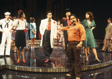 "Luis Valdez (Center right) with the cast of the world premiere of ""Zoot Suit"" at the Mark Taper Forum in 1978.Written and directed by Luis Valdez and presented in association with El Teatro Campesino, the revival of ""Zoot Suit"" will play January 31 through March 12, 2017, as part of Center Theatre Group/Mark Taper Forum's 2017-2018 season at the Los Angeles Music Center. Tickets for the Mark Taper Forum's 50th anniversary season are currently available by season ticket membership only. For information and to charge season tickets by phone, call the Exclusive Season Ticket Hotline at (213) 972-4444. To purchase season memberships online, visit www.CenterTheatreGroup.org/Taper. Contact: CTGMedia@ctgla.org / (213) 972-7376. Photo by Jay Thompson."