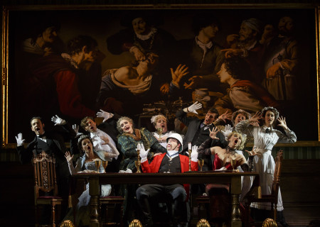 """National Touring Company. The cast with John Rapson as Lord Adalbert D'Ysquith (red) in a scene from """"A Gentleman's Guide to Love & Murder."""" Directed by Darko Tresnjak, """"A Gentleman's Guide to Love & Murder"""" is part of the Center Theatre Group/Ahmanson Theatre's 2015-2016 season and will be presented March 22 through May 1, 2016. For tickets and information, please visit CenterTheatreGroup.org or call (213) 972-4400.<br /> Contact: CTGMedia@CenterTheatreGroup.org / (213) 972-7376<br /> Photo by Joan Marcus."""