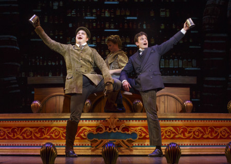 """National Touring Company. (L-R) John Rapson as Henry D'Ysquith, Megan Loomis and Kevin Massey as Monty Navarro in a scene from """"A Gentleman's Guide to Love & Murder."""" Directed by Darko Tresnjak, """"A Gentleman's Guide to Love & Murder"""" is part of the Center Theatre Group/Ahmanson Theatre's 2015-2016 season and will be presented March 22 through May 1, 2016. For tickets and information, please visit CenterTheatreGroup.org or call (213) 972-4400.<br /> Contact: CTGMedia@CenterTheatreGroup.org / (213) 972-7376<br /> Photo by Joan Marcus."""