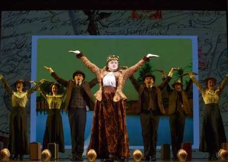 """National Touring Company.  The cast with John Rapson as Lady Hyacinth D'Ysquith in a scene from """"A Gentleman's Guide to Love & Murder."""" Directed by Darko Tresnjak, """"A Gentleman's Guide to Love & Murder"""" is part of the Center Theatre Group/Ahmanson Theatre's 2015-2016 season and will be presented March 22 through May 1, 2016. For tickets and information, please visit CenterTheatreGroup.org or call (213) 972-4400.<br /> Contact: CTGMedia@CenterTheatreGroup.org / (213) 972-7376<br /> Photo by Joan Marcus."""