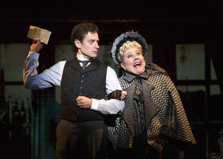 """National Touring Company. Kevin Massey as Monty Navarro and Mary VanArsdel as Miss Shingle in a scene from """"A Gentleman's Guide to Love & Murder."""" Directed by Darko Tresnjak, """"A Gentleman's Guide to Love & Murder"""" is part of the Center Theatre Group/Ahmanson Theatre's 2015-2016 season and will be presented March 22 through May 1, 2016. For tickets and information, please visit CenterTheatreGroup.org or call (213) 972-4400.<br /> Contact: CTGMedia@CenterTheatreGroup.org / (213) 972-7376<br /> Photo by Joan Marcus."""