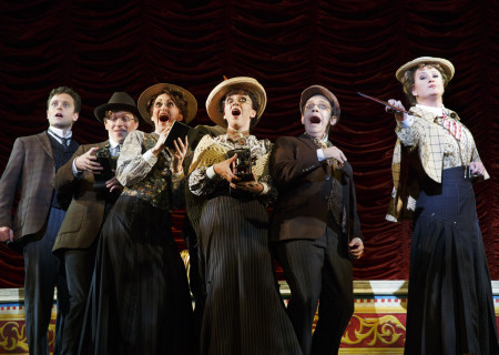 """National Touring Company. The cast with Kevin Massey as Monty Navarro (left) and Megan Loomis as Tour Guide (right) in a scene from """"A Gentleman's Guide to Love & Murder."""" Directed by Darko Tresnjak, """"A Gentleman's Guide to Love & Murder"""" is part of the Center Theatre Group/Ahmanson Theatre's 2015-2016 season and will be presented March 22 through May 1, 2016. For tickets and information, please visit CenterTheatreGroup.org or call (213) 972-4400.<br /> Contact: CTGMedia@CenterTheatreGroup.org / (213) 972-7376<br /> Photo by Joan Marcus."""