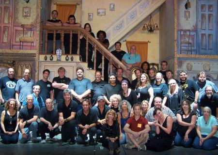 "Andy Arnold (standing, fifth from left) with the crew of ""Mary Poppins"" at the Ahmanson Theatre in 2012."