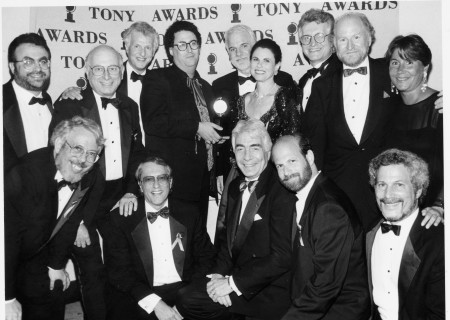 "Gordon Davidson (center front row) with Tony Kushner (center-left back row, holding Tony Award) and producers of ""Angels in America"" after winning the Tony."
