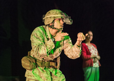 "Peter Mendoza and Caro Zeller (background) in ""Elliot, A Soldier's Fugue"" at Center Theatre Group's Kirk Douglas Theatre. Directed by Shishir Kurup and written by Quiara Alegría Hudes, ""Elliot, A Soldier's Fugue"" will play through February 25, 2018. For tickets and information, please visit CenterTheatreGroup.org or call (213) 628-2772. Media Contact: CTGMedia@CTGLA.org / (213) 972-7376. Photo by Craig Schwartz."
