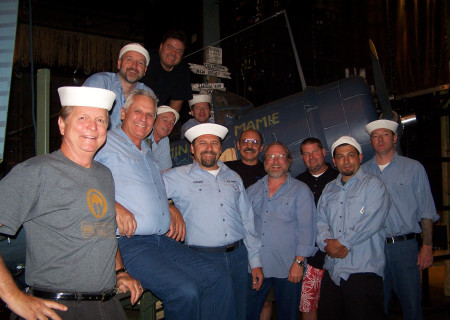 "Andy Arnold (top, in black T-shirt) with the crew of ""South Pacific"" at the Ahmanson Theatre in 2010."