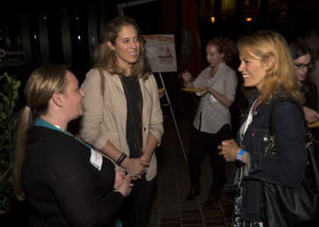 <em>Disgraced</em> cast member Emily Swallow (right) speaks with attendees.